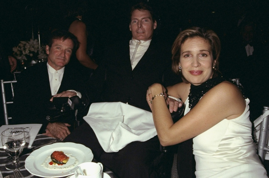 Actor Robin Williams (seated, left) joins Christopher Reeve