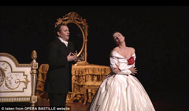 Cast members performing La Traviata at the Bastille Opera opera house in Paris objected to the veiled woman in the audience. It is not suggested that either of the performers pictured were among those who complained Read more: http://www.dailymail.co.uk/news/article-2799981/woman-thrown-paris-opera-cast-refused-perform-unless-removed-muslim-veil.